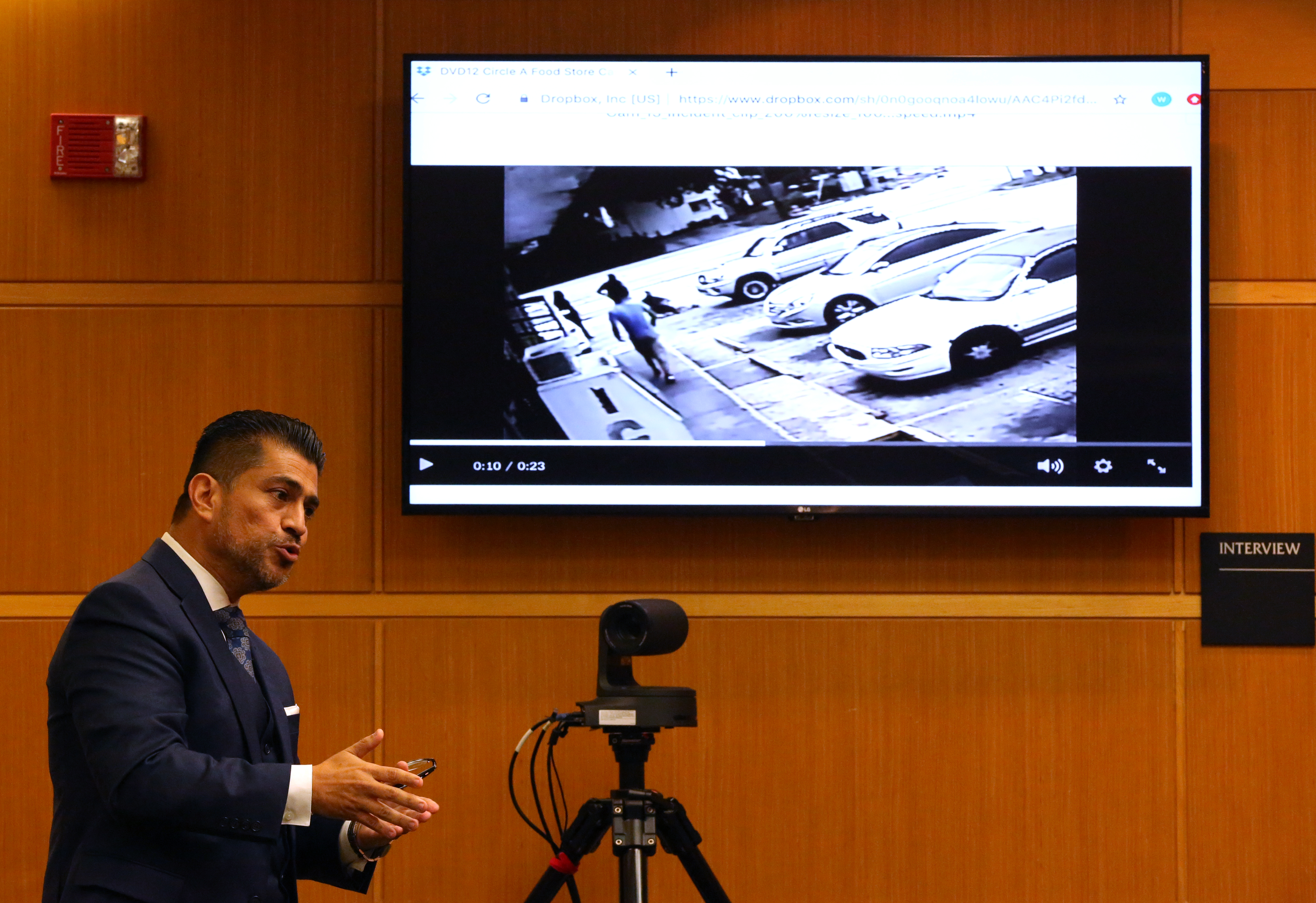 During his opening speech Wednesday in the manslaughter trial against Michael Drejka, defender Bryant Camareno shows the jury the video of Drejka's shooting of Markeis McGlockton in front of the Circle A Food Mart in July 2018. [SCOTT KEELER   |   Times] SCOTT KEELER | Times