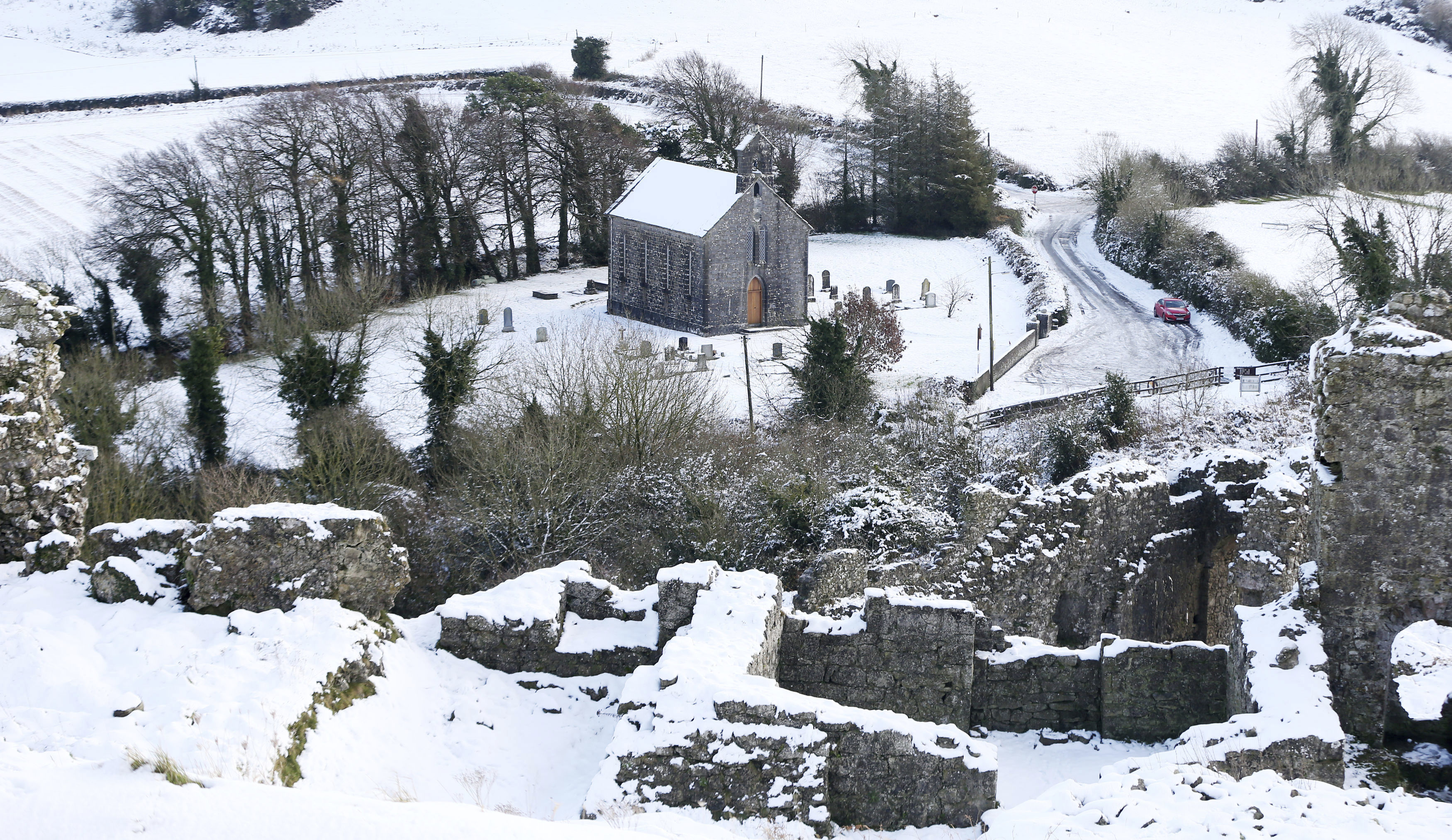 Gallery a weekend of snow from the us to europe snow covered hills around the holy trinity anglican church in aghnahily co laois ireland monday dec 11 2017 niall carsonpa via ap madrichimfo Images
