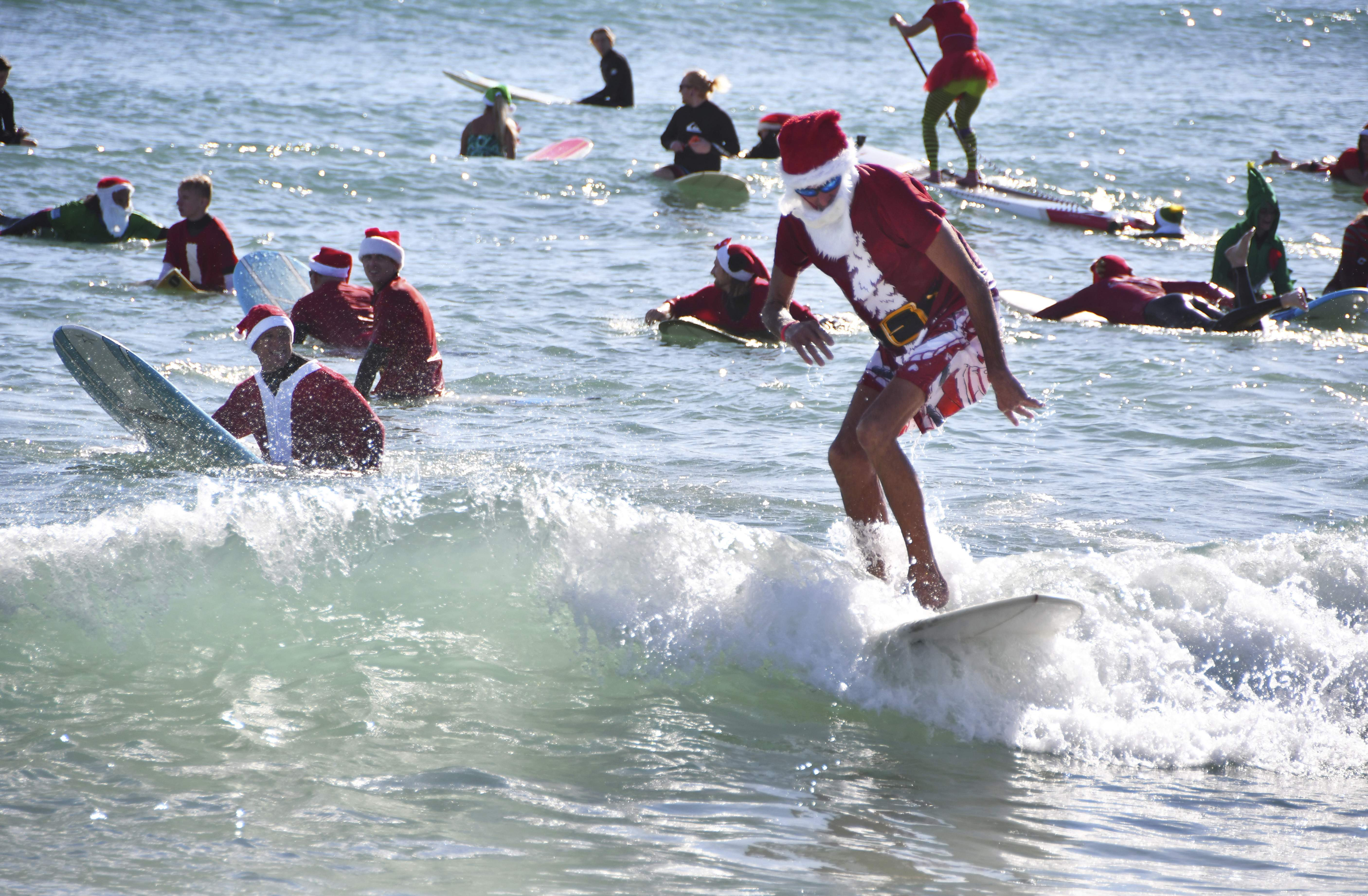 Florida Christmas.A Florida Christmas Hundreds Of Surfers In Santa Suits Ride